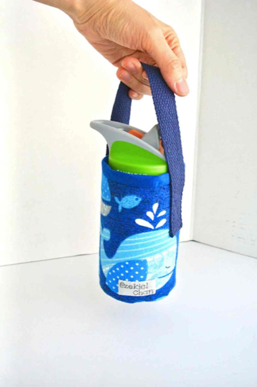 Finished DIY Insulated Water Bottle Holder Bag Carrier being held from handles