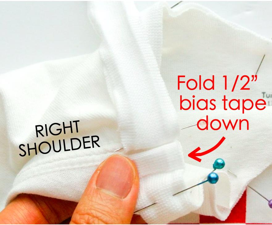 How to alter crew neck t shirt neckline. Pinning bias tape around neckline