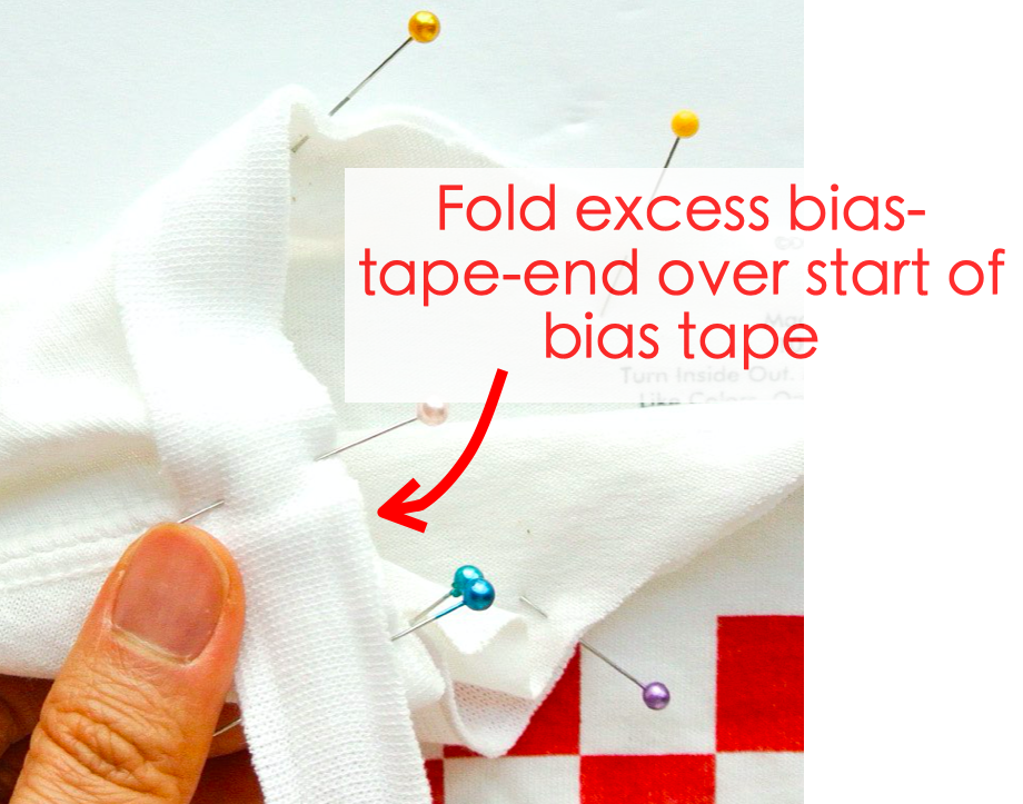 How to alter crew neck t shirt neckline. Folding excess bias tape end over start of bias tape