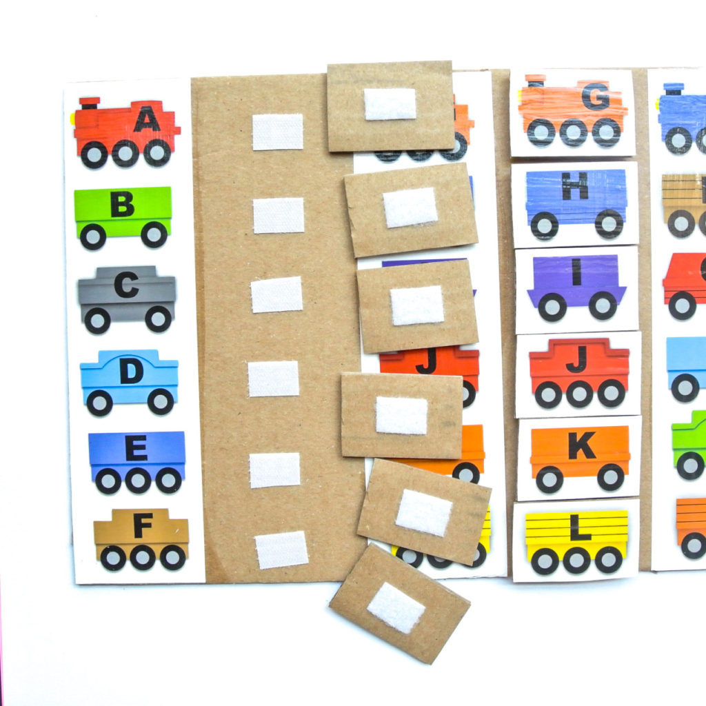 Shows Back side of Train pieces with velcro for ABC matching Train Activity