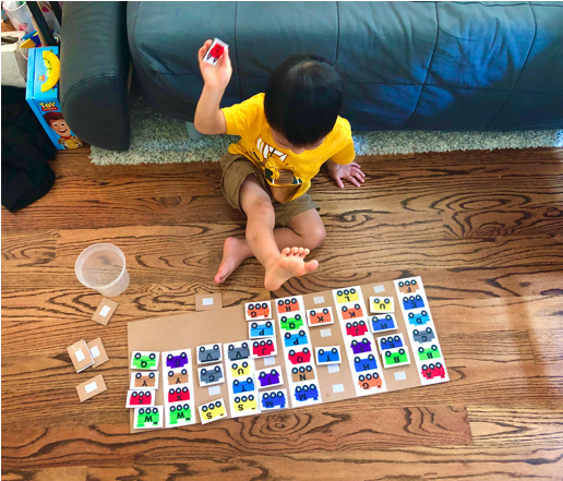 Shows a toddler trying to match train letters on the ABC train letter Matching toddler activity
