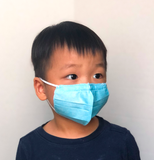 Toddler wearing his new fitted surgical face mask