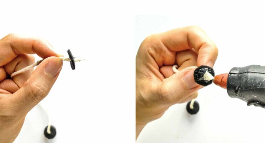 Shows hands applying glue to black felt circle and thread for making magnetic fishing rod for kids