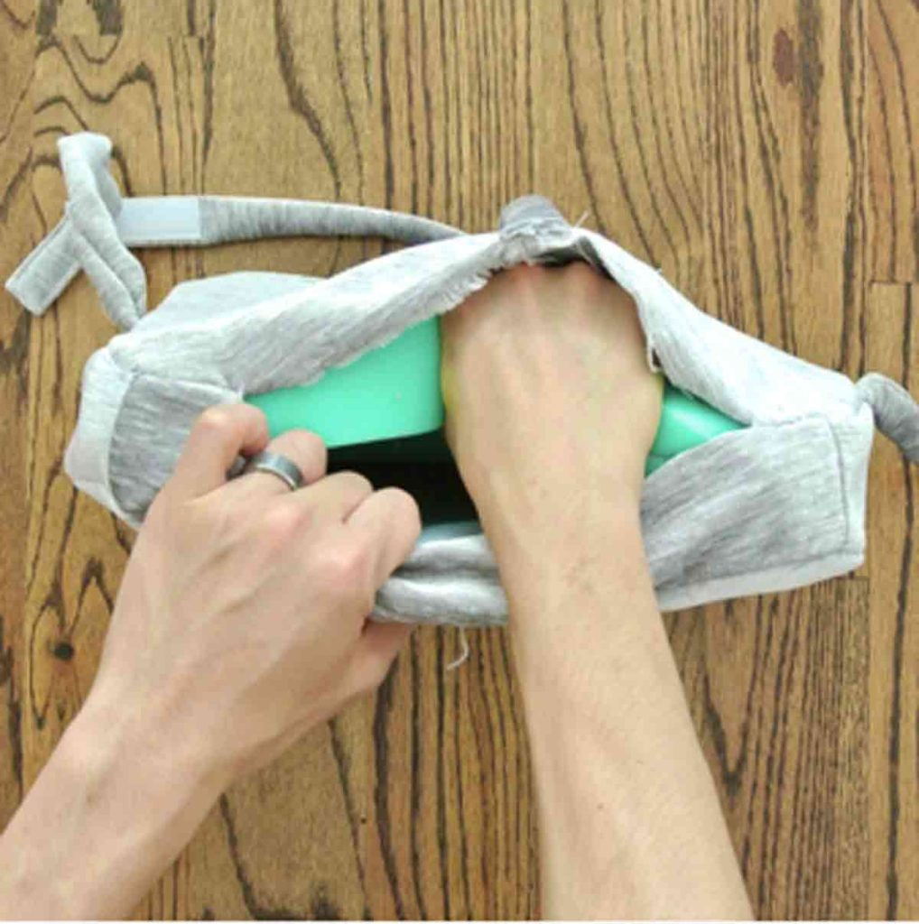 Shows Hands Placing foam into square bar stool cushions