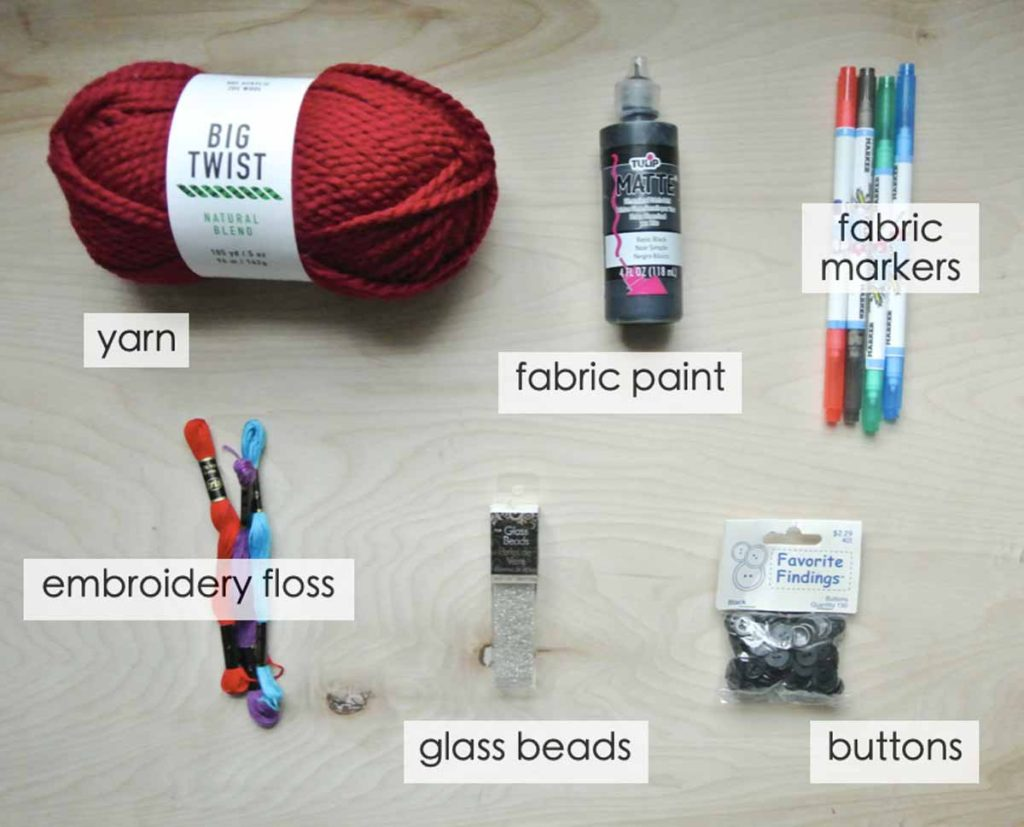 Shows other materials good for making custom plush doll: yarn, beads/sequence, plastic eyes and nose, embroidery floss, buttons, fabric paint and markers. How to Make Plushie tutorial