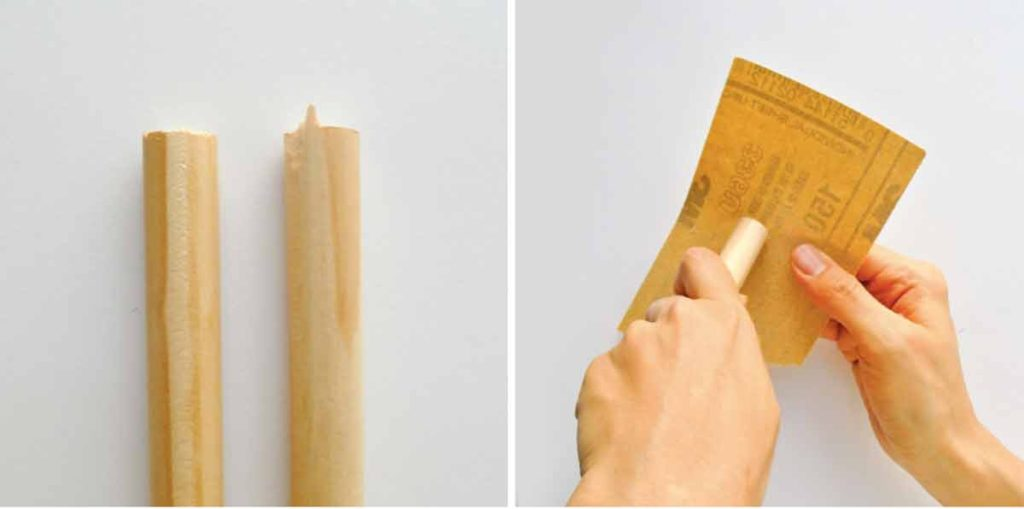 Shows hands sanding down wooden rod to make magnetic fishing rod for kids
