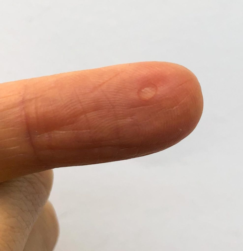 Drop of Water at finger tip