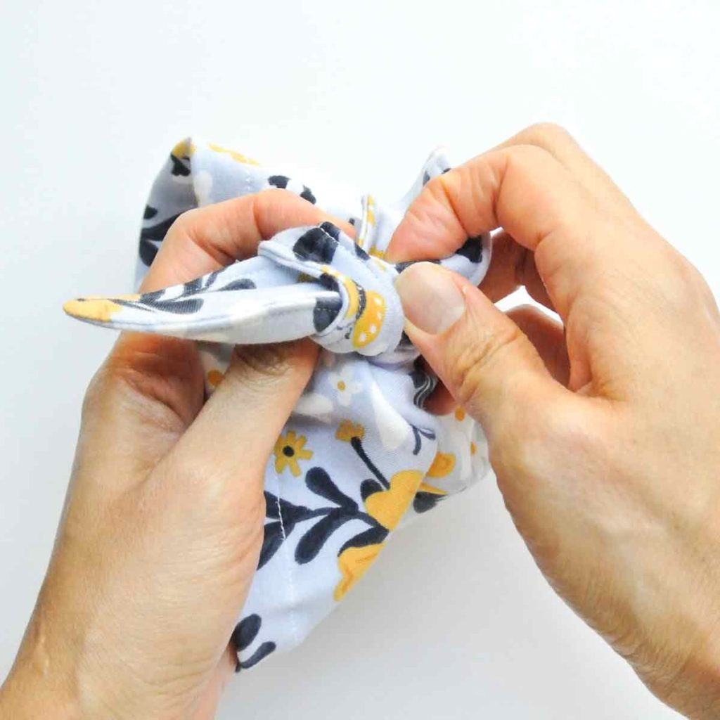 Tying front knot on DIY baby bow hat