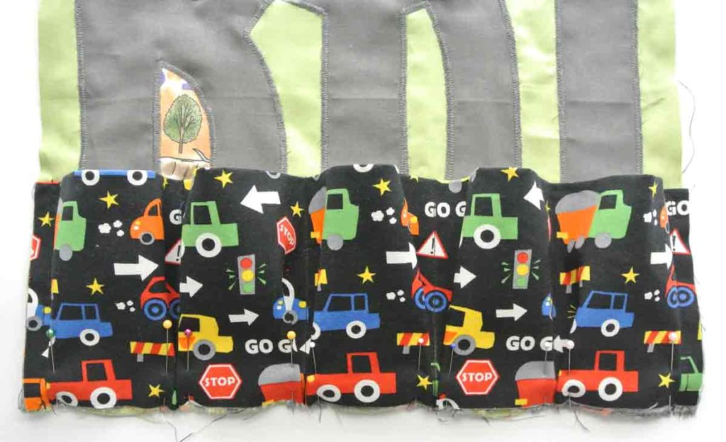 DIY toy car carrier bottom of pockets piece pinned to play mat