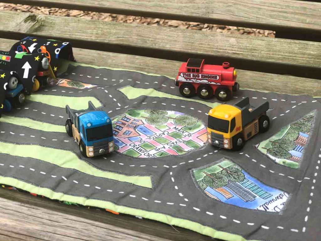 Finished DIY Toy Car Train Carrier Play Mat with trucks and red engine on them