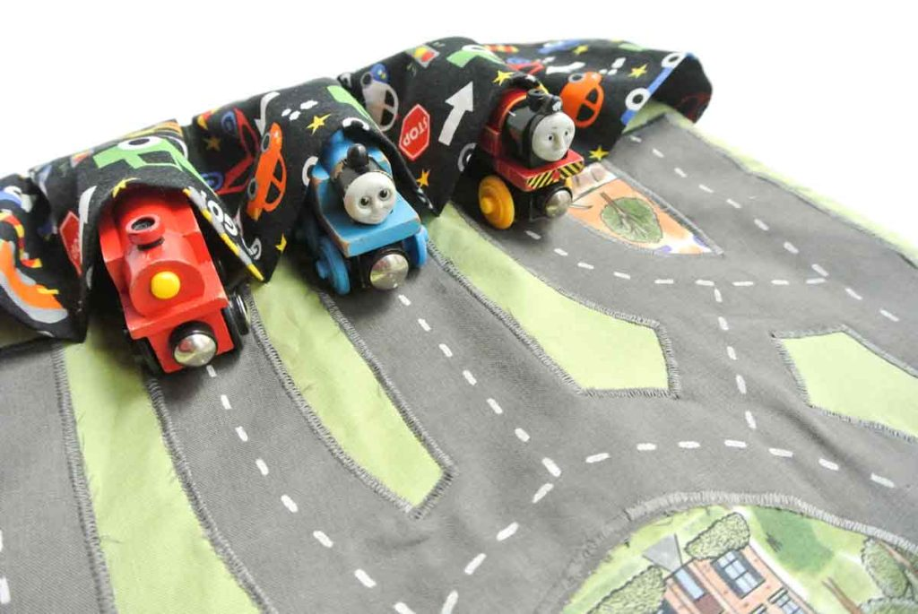 Finished DIY Toy Car Play mat Carrier Case with trains tucked into pocket.