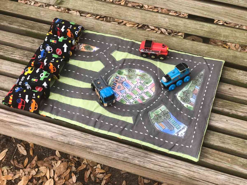 Finished DIY Toy Car Carrier Play mat case with trains and cars running on play mat track