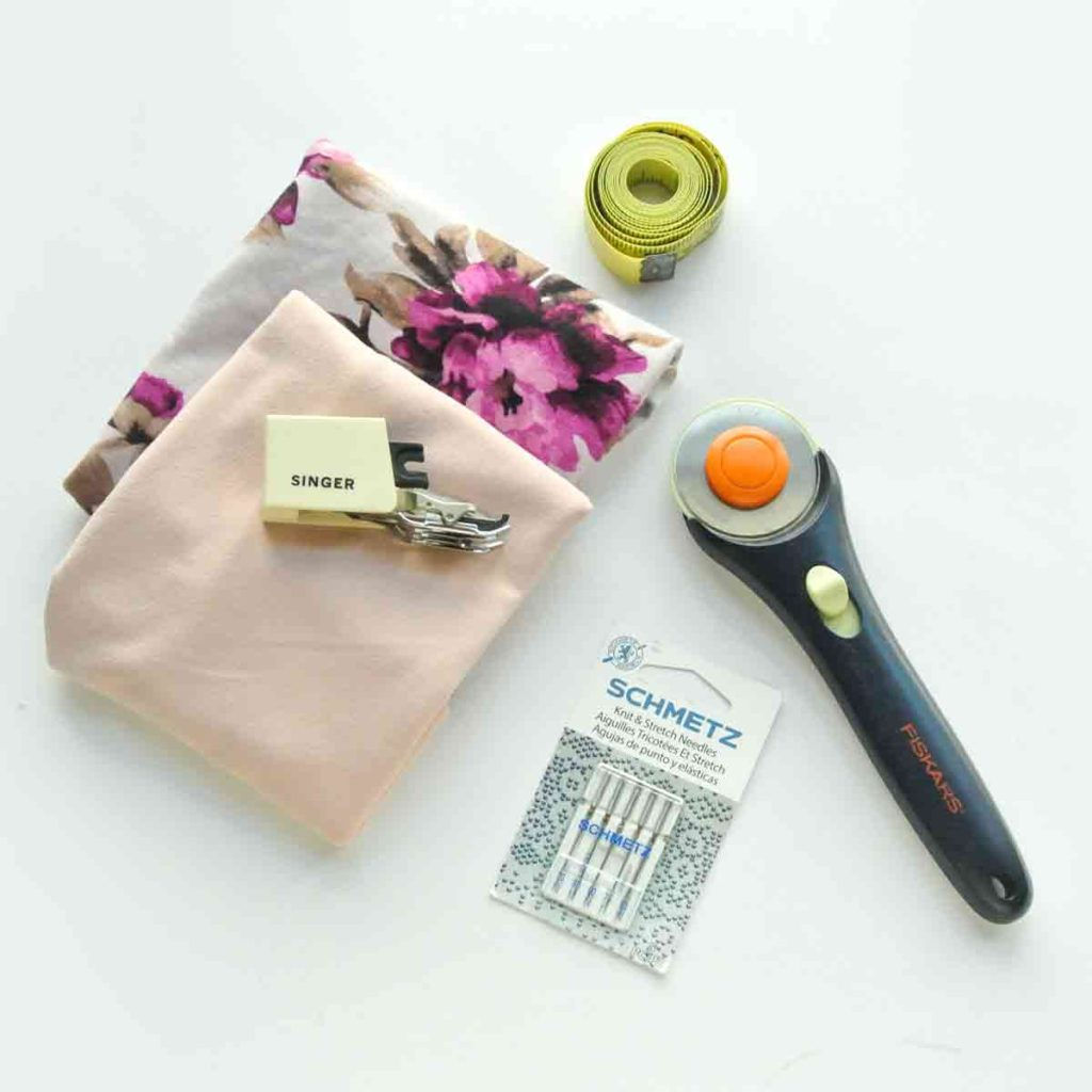 Knit fabrics, walking foot, rotary cutters, stretch needles, and measuring tape. Tools needed to sew knit fabrics beautifully