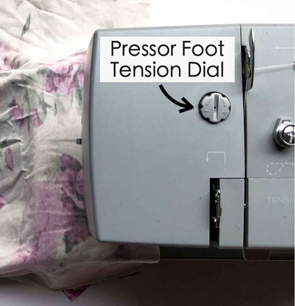 Shows pressor foot pressure dial on singer heavy duty sewing machine