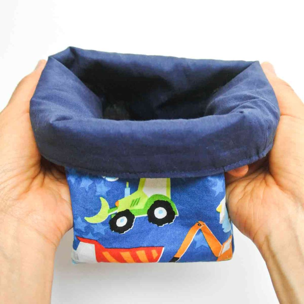 Fabric storage bins pattern folding top edge of baskets over