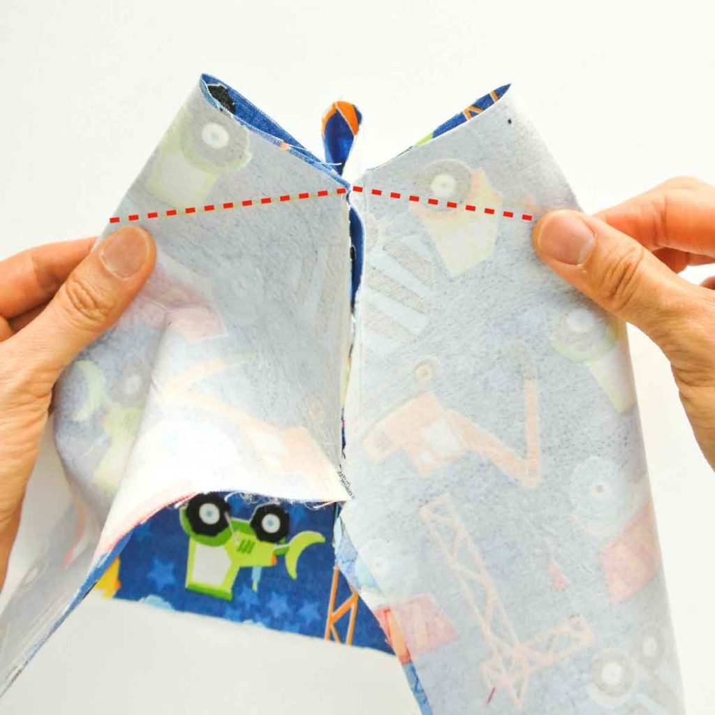 Shows how to sew darts of square bottom of DIY fabric basket