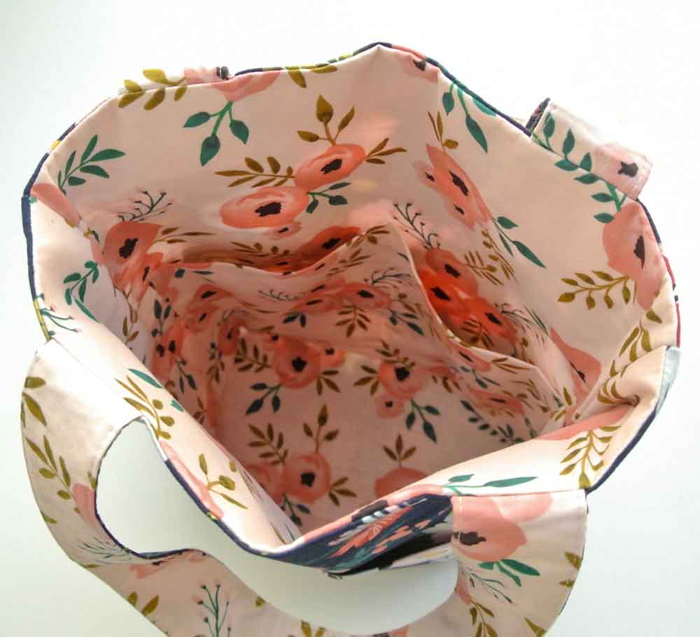 Shows interior of reversible tote bag with pocket sleeves