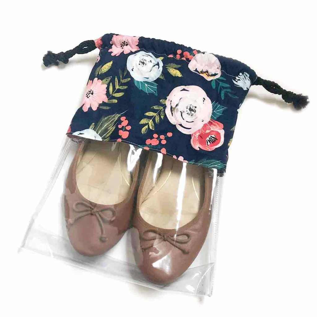Shows Finished Medium Sized Drawstring Shoe Bag with a pair of ballet flats inside