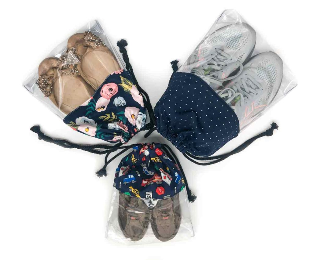 Shoes 3 clear drawstring shoe bags in size large, medium, and small with 3 different pairs of shoes