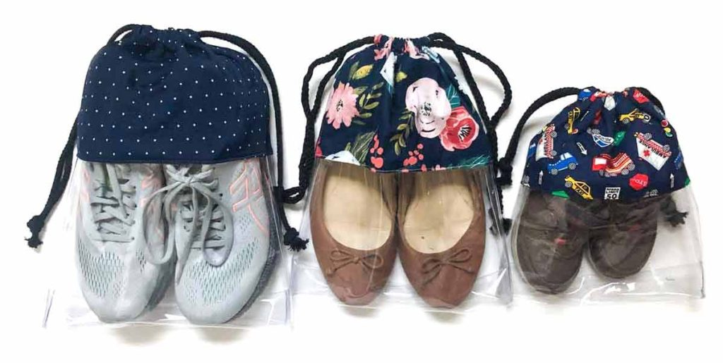 How to make drawstring shoe bag. Shoes 3 drawstring shoe bags with 3 pairs of shoes in size large, medium, and small.