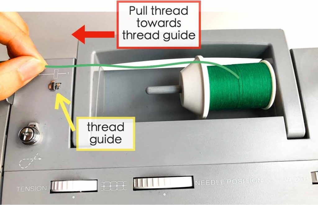 How to Wind and thread the bobbin. Thread from thread spool pulled to the left towards thread guide