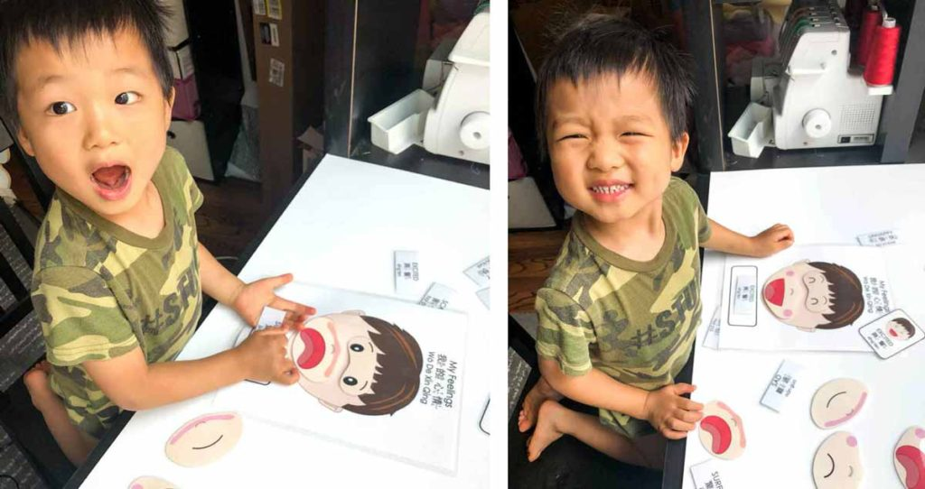 Toddler boy making faces with Free Printable Emotions Matching Activity in Bilingual English and Chinese