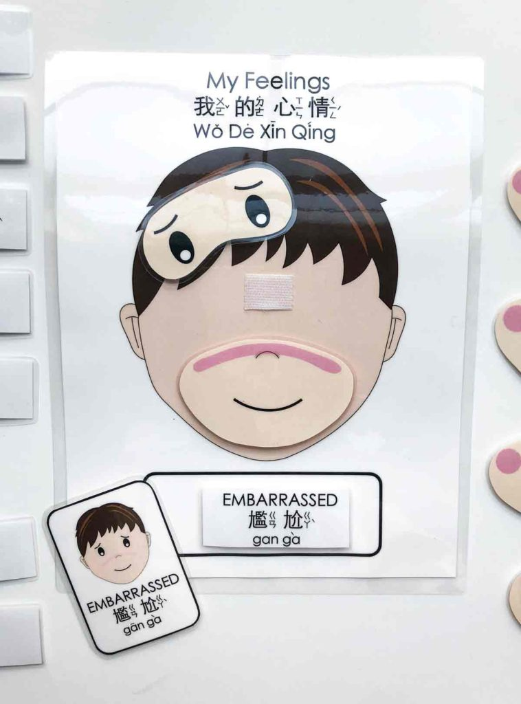 Blank child face with velcro attached and facial expressions and emotion labels and corresponding flashcard. Free Printable Emotions Matching Activity Bilingual English and Chinese