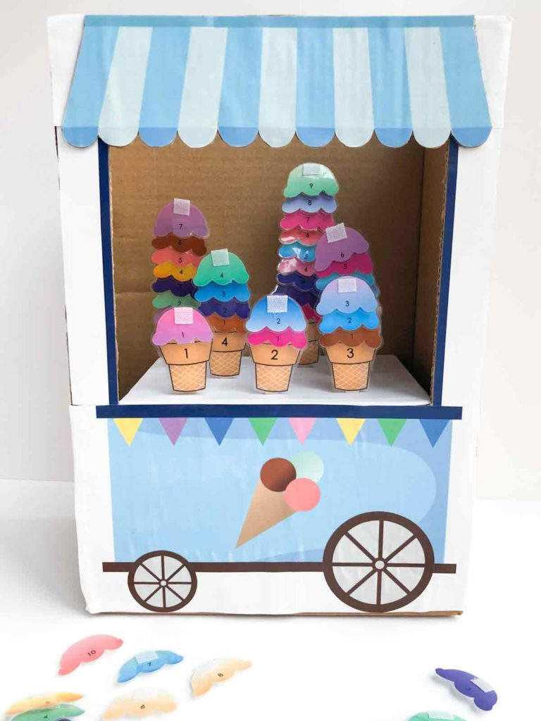 Shows Finished ice cream cart with ice cream in it and ice cream number scoops on the side. Count to 10 ice cream actiity