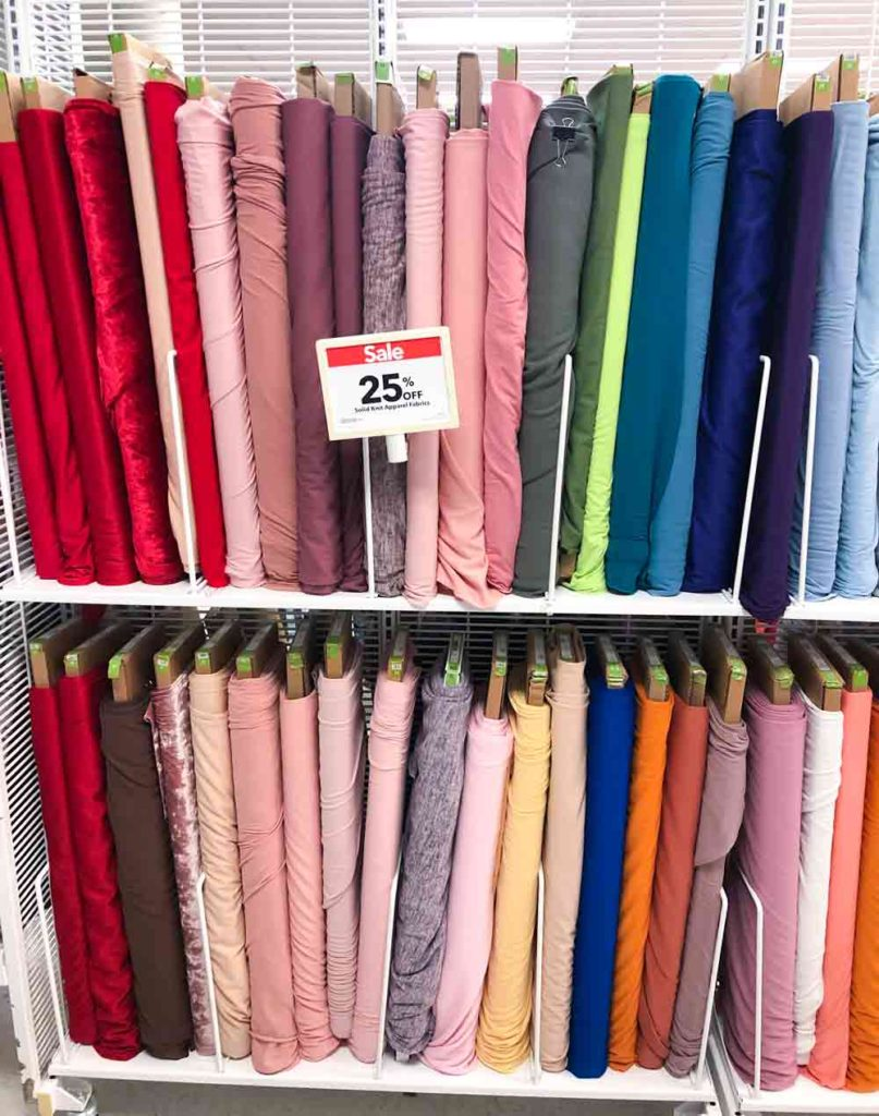 what fabric is best for baby bibs. Bolts of solid jersey knit fabric at fabric shop